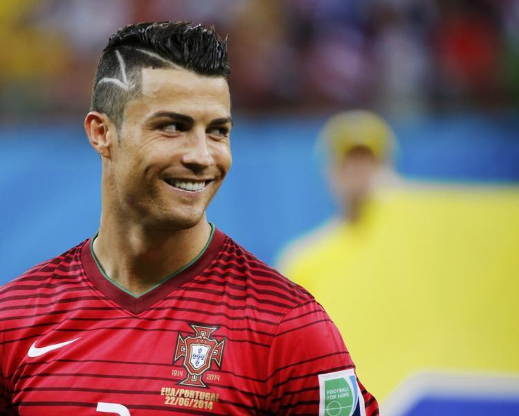 C羅在2014年世界盃第二場小組賽換了個髮型,當時立刻成為媒體討論焦點。圖/摘自...