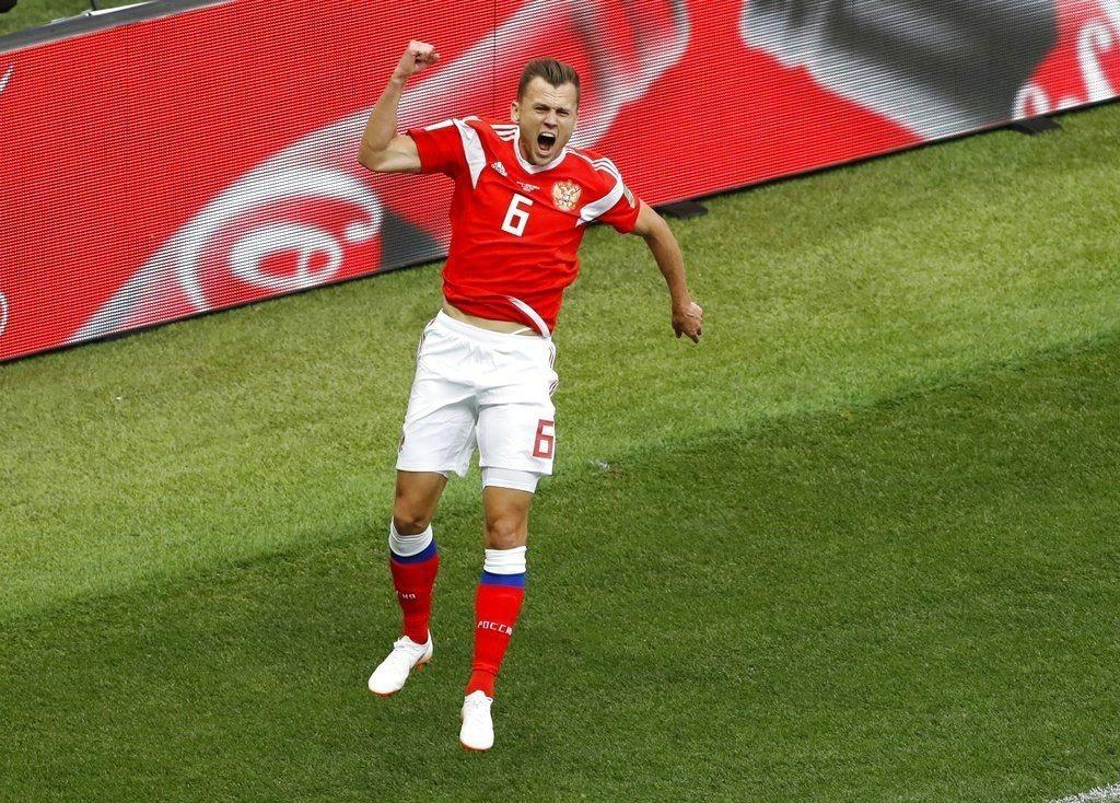 俄羅斯切里謝夫攻破埃及球門,振臂歡呼。美聯社