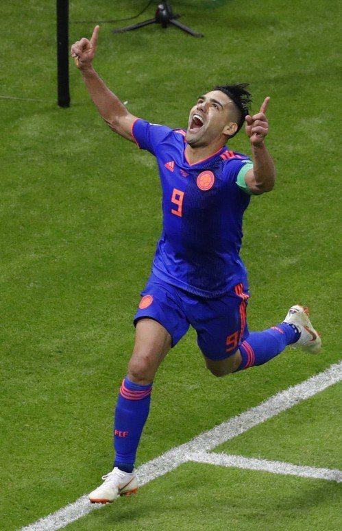 哥倫比亞法爾考進球後歡呼。美聯社