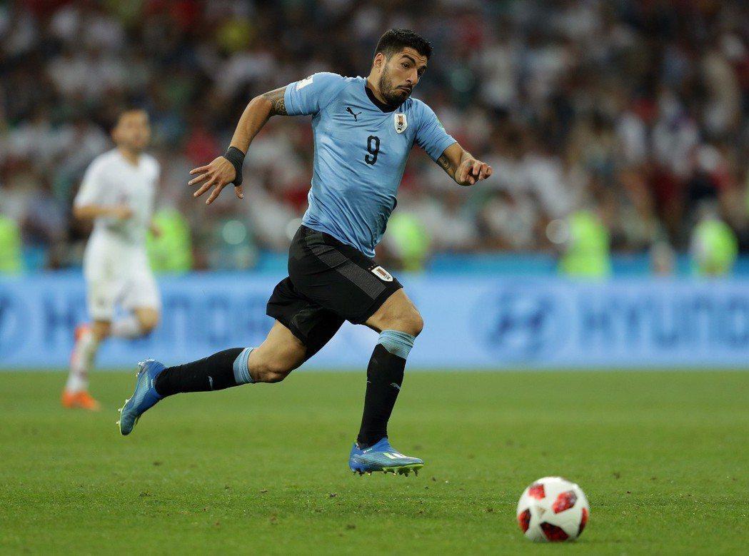 想帶烏拉圭奪冠,蘇亞雷斯力甩「咬人」爭議形象。 美聯社