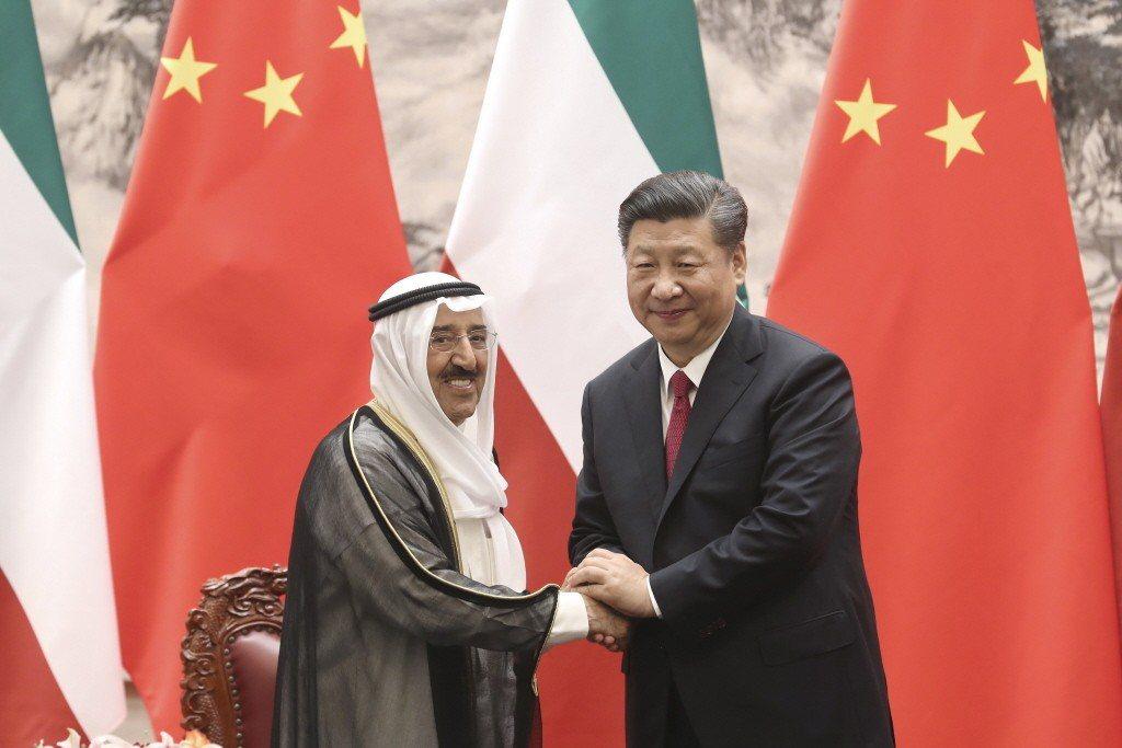 圖為中國國家主席習近平在北京人民大會堂雨科威特埃米爾薩巴赫舉行會談。中新社