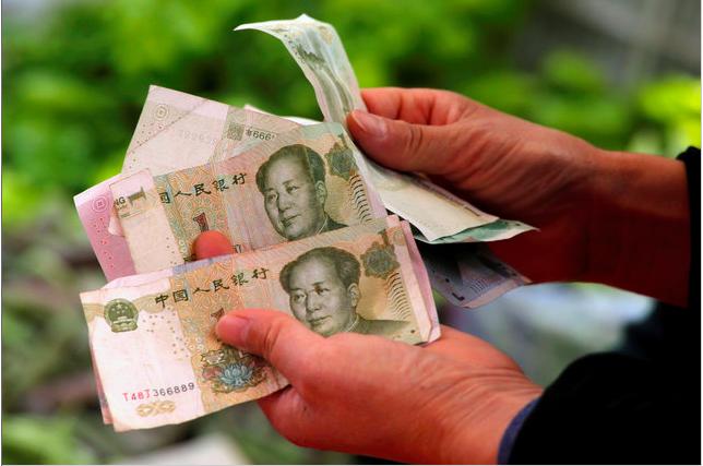 中美貿易戰升溫,美元資產受追捧,人民幣兌美元在岸價(CNY)12日早上時段一度跌...