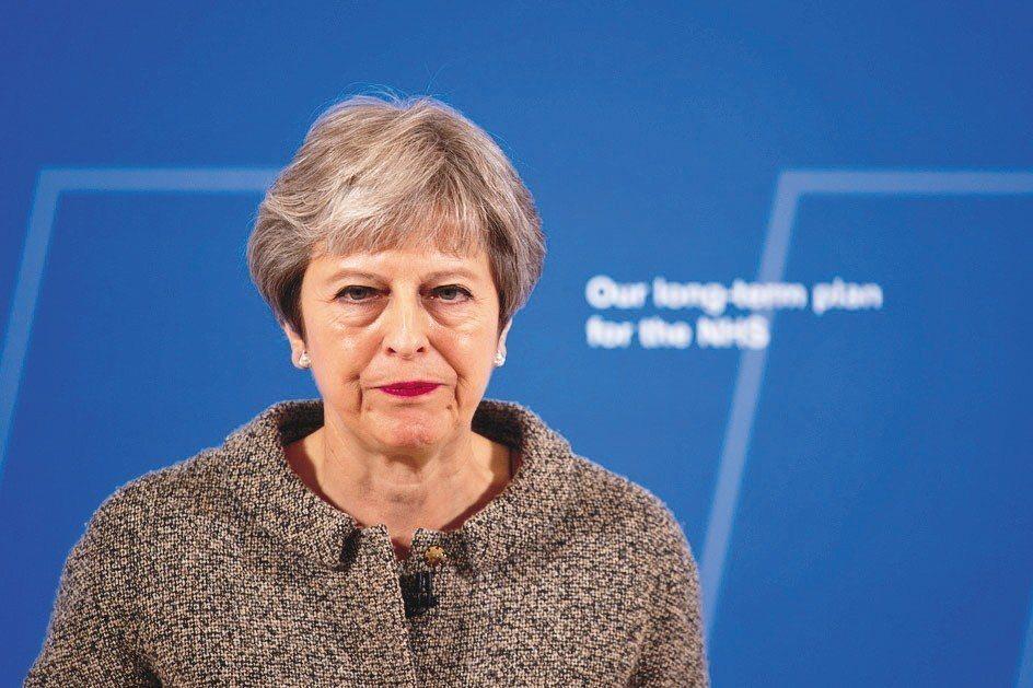 英國首相梅伊在脫歐議題上,恐和其領導的保守黨「災難性分裂」。 歐新社