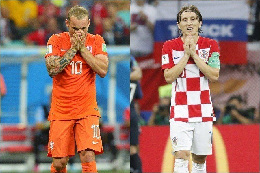 世足冠軍賽後莫德里奇雨中落寞的背影,讓人想起8年前的「荷蘭師奶」斯奈德。 歐新社