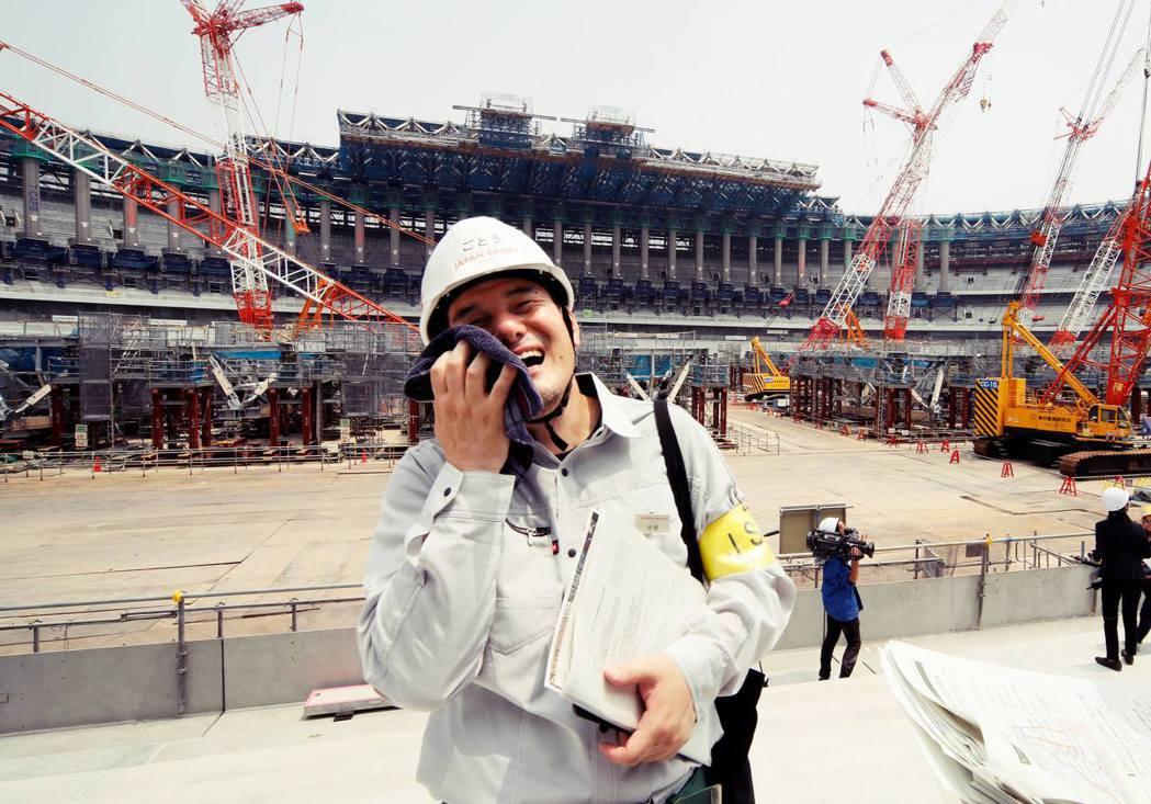 酷暑之下辛苦工作的日本大叔。 圖/歐新社