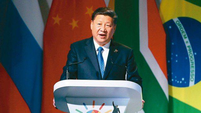 大陸國家主席習近平出席金磚國家論壇時,暗批美國發動貿易戰不可取,經濟霸權主義更要...