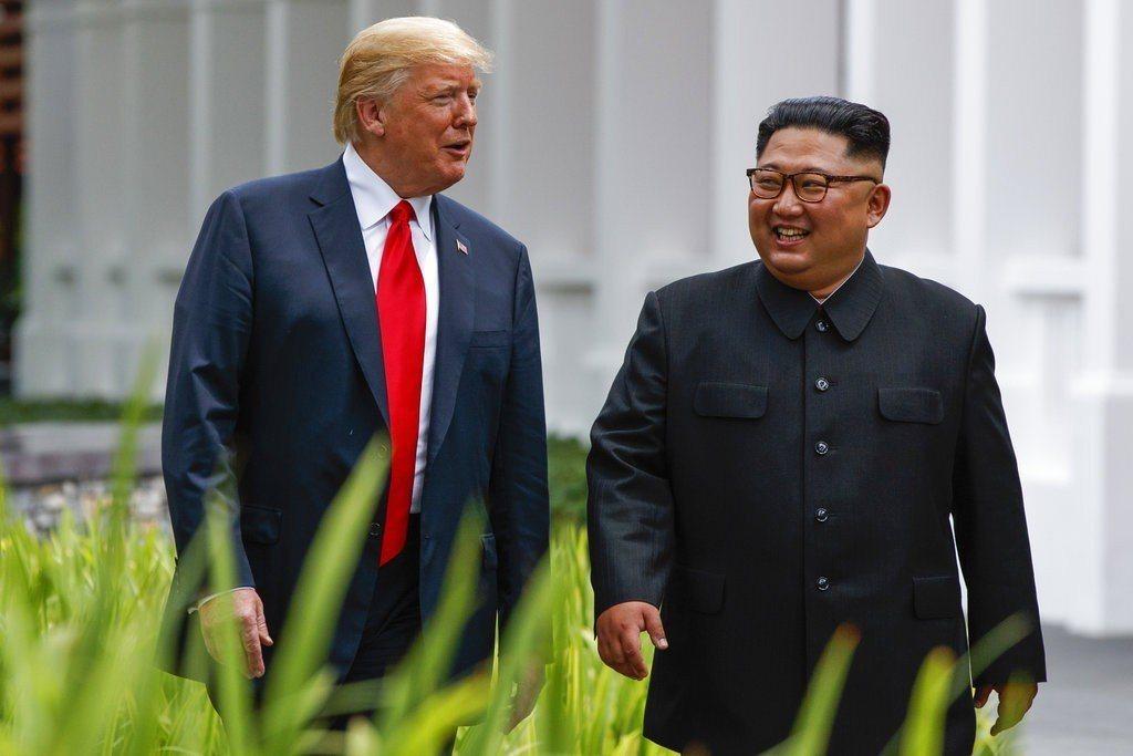 圖為美國總統川普與北韓領導人金正恩。美聯社資料照