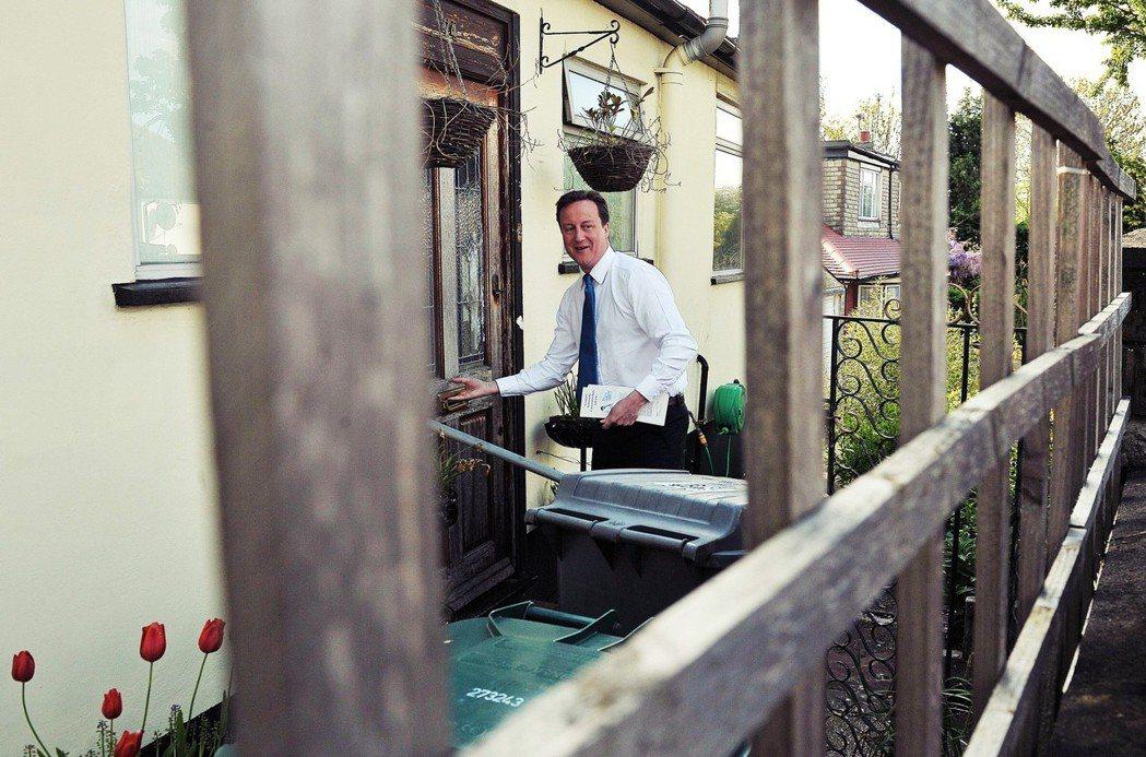 更新過後的諾丁丘,成了倫敦最炙手可熱的住宅區之一。圖為前英國首卡麥隆。 圖/美聯...