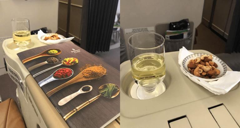 起飛沒多久後,附送的香檳和堅果 圖文來自於:TripPlus ※ 提醒您:禁...