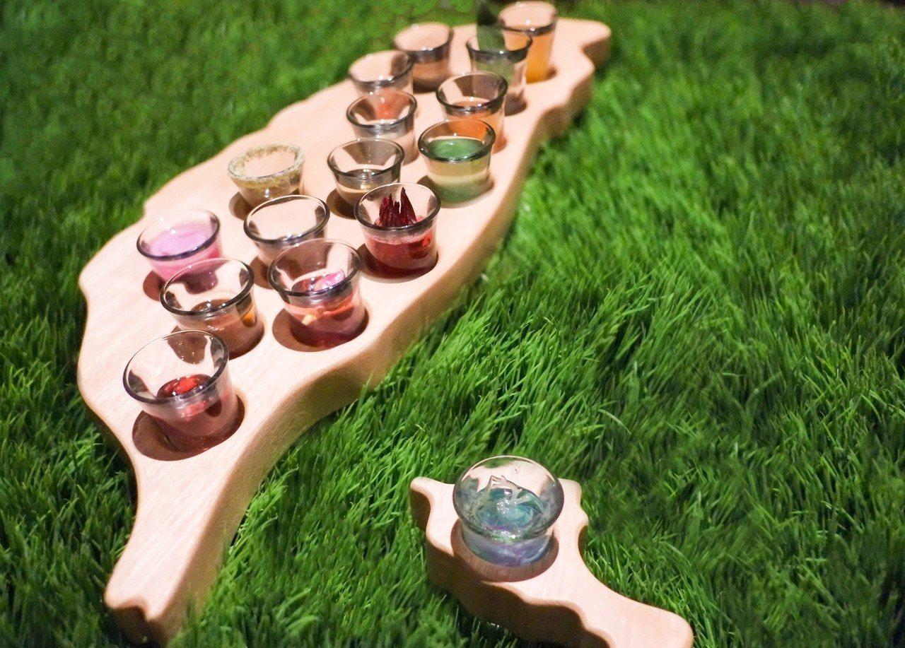 太魯閣晶英酒店推出「部落巡禮16族」小米酒特調,並以台灣造型盛裝上桌,讓遊客認識...