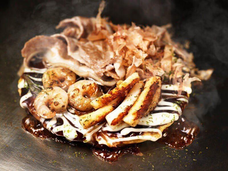 吃得到蝦、豬肉等配料的道頓崛燒,是千房的招牌菜。圖/取自千房官網