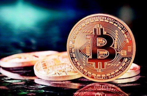 加密貨幣指標比特幣昨(15)日勁揚逾600美元。 圖/聯合報系資料照片