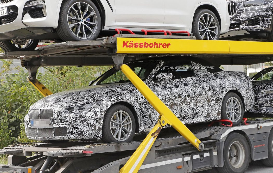 全新世代BMW 4-Series Convertible偽裝測試車。 摘自Carscoops