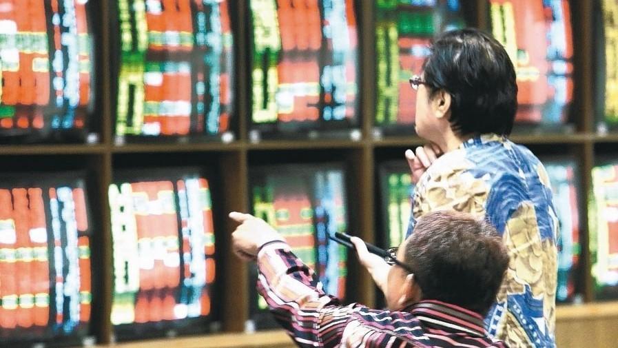 稅局提醒,企業出售股票須持有逾三年,才可減半計入基本所得額課稅。 本報系資料庫