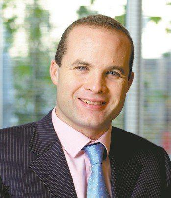 安本環球新興市場公司債券基金經理人Brett Dimnet。圖/安本標準投信提供