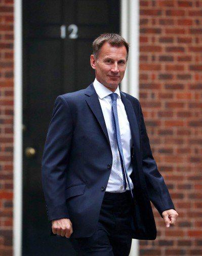 英國外交大臣韓特在報告指,即使港獨不合乎現實,但言論自由仍受《基本法》及《中英聯...