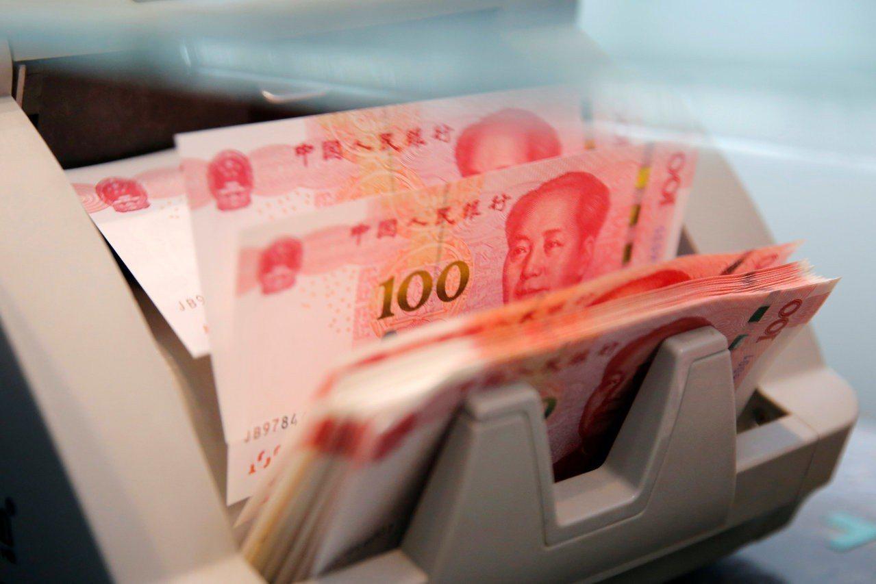 人民幣貶值仍未引發資本大舉外流。(圖/路透)