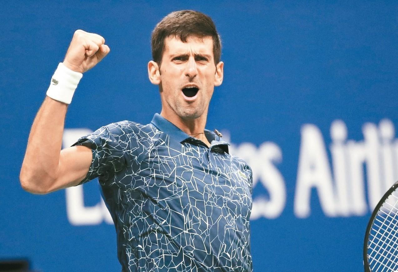 塞爾維亞的約克維奇在美網男單決賽得分後振臂,他最後贏得冠軍。 (新華社)