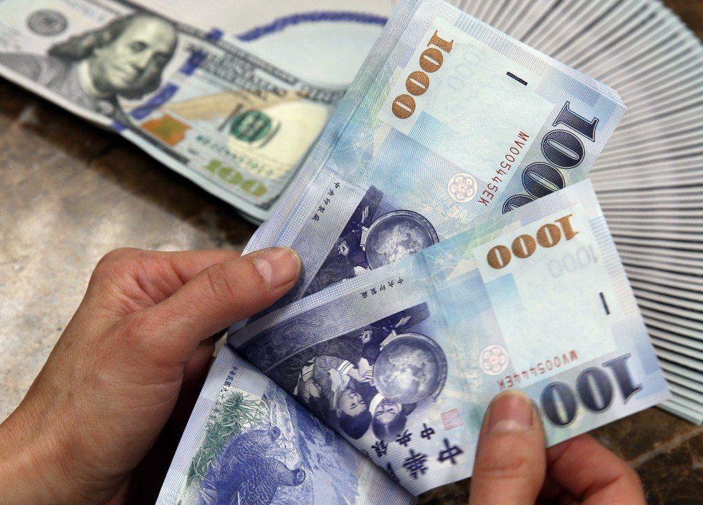 新台幣兌美元今天收盤收30.814元,升1.6分。 聯合報系資料照