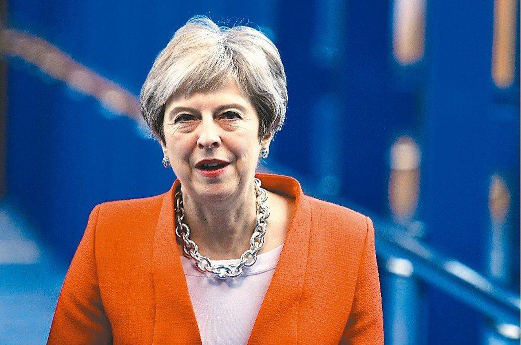 英國計劃調高外國人購買房地產的稅率國,圖為英國首相梅伊。 (路透)