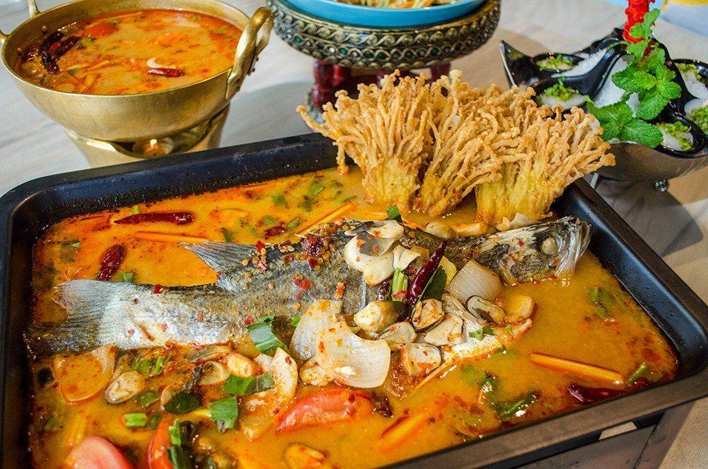 (圖/台灣旅行趣) ▲鱸魚的鮮甜被香料與酸辣湯給襯托出來,撲鼻而來的香味讓人口水...