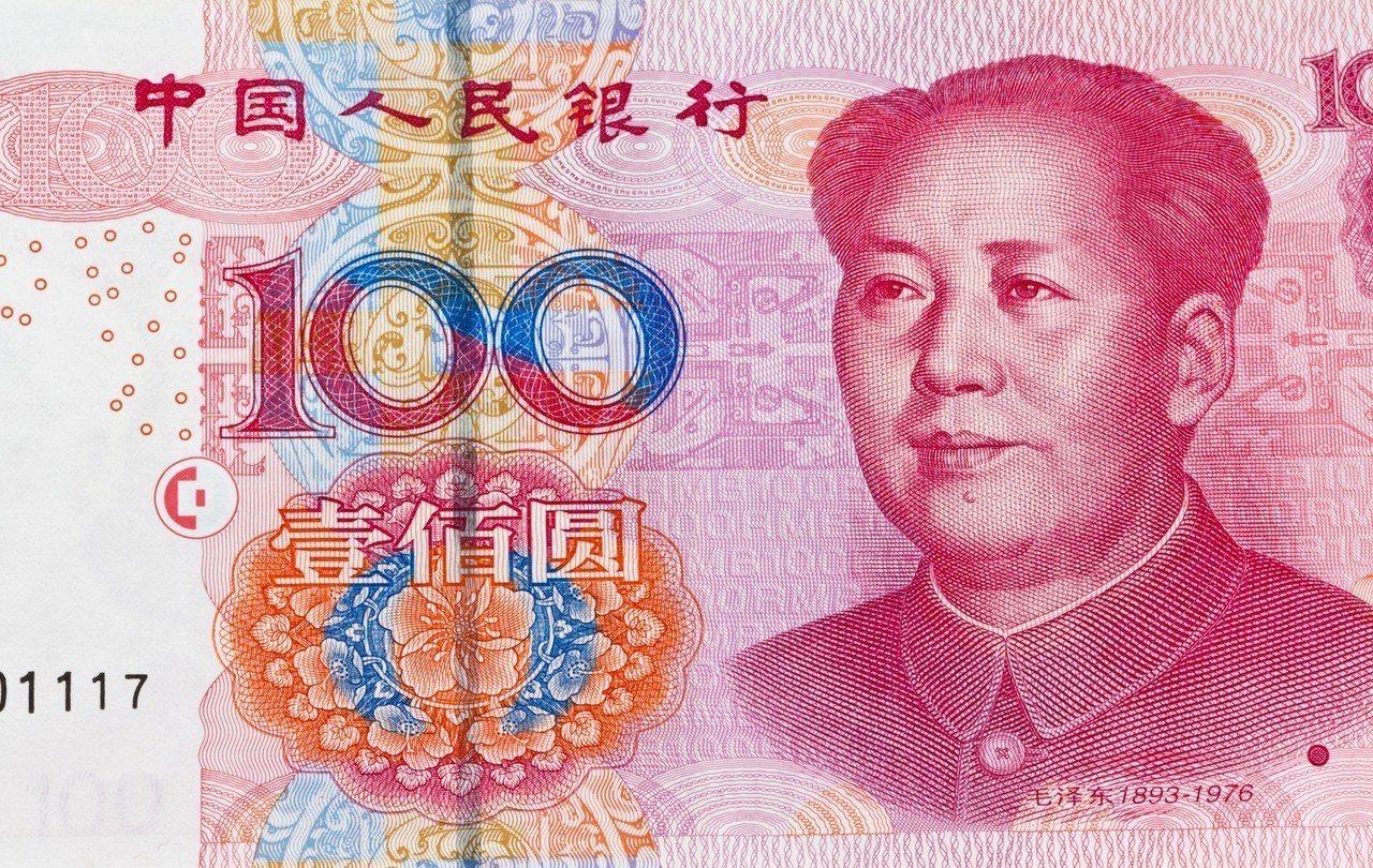 人民幣兌美元匯率中間價16日上調35個基點(0.35分),報1美元兌人民幣6.9...