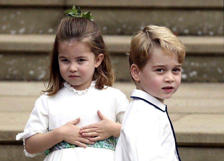 喬治小王子和夏綠蒂小公主擔任尤金妮公主婚禮的花童,萌樣深受歡迎。圖/美聯社