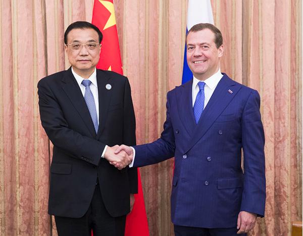 大陸國務院總理李克強12日下午在杜尚別與俄羅斯總理麥維德夫會面。圖/新華社