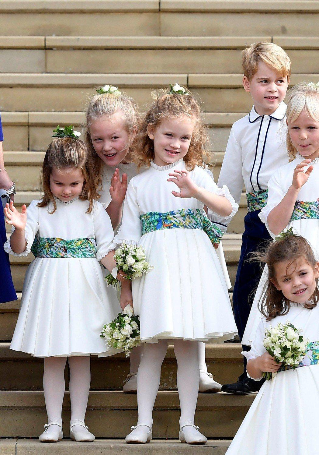 一群超可愛的小娃兒組成超萌花童團。(路透)
