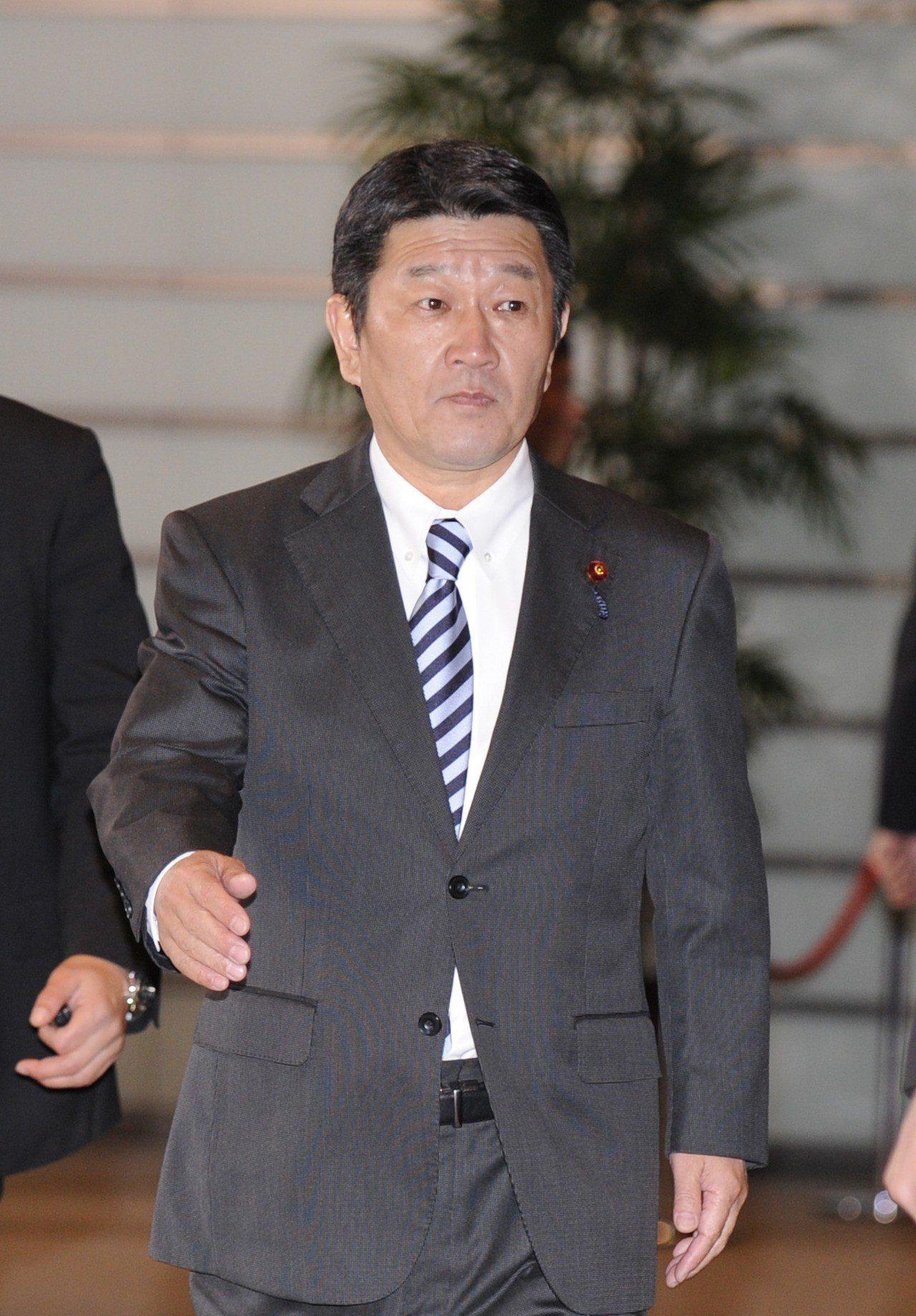 日本經濟再生大臣茂木敏充。 新華社