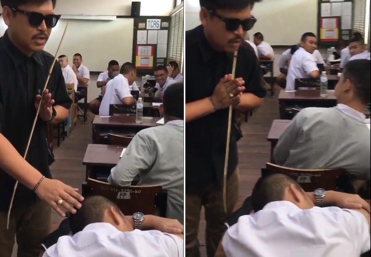 泰國一名年輕老師一手合掌、一手輕放在學生頭上,口中念念有詞,試圖喚醒「靈魂出竅」...
