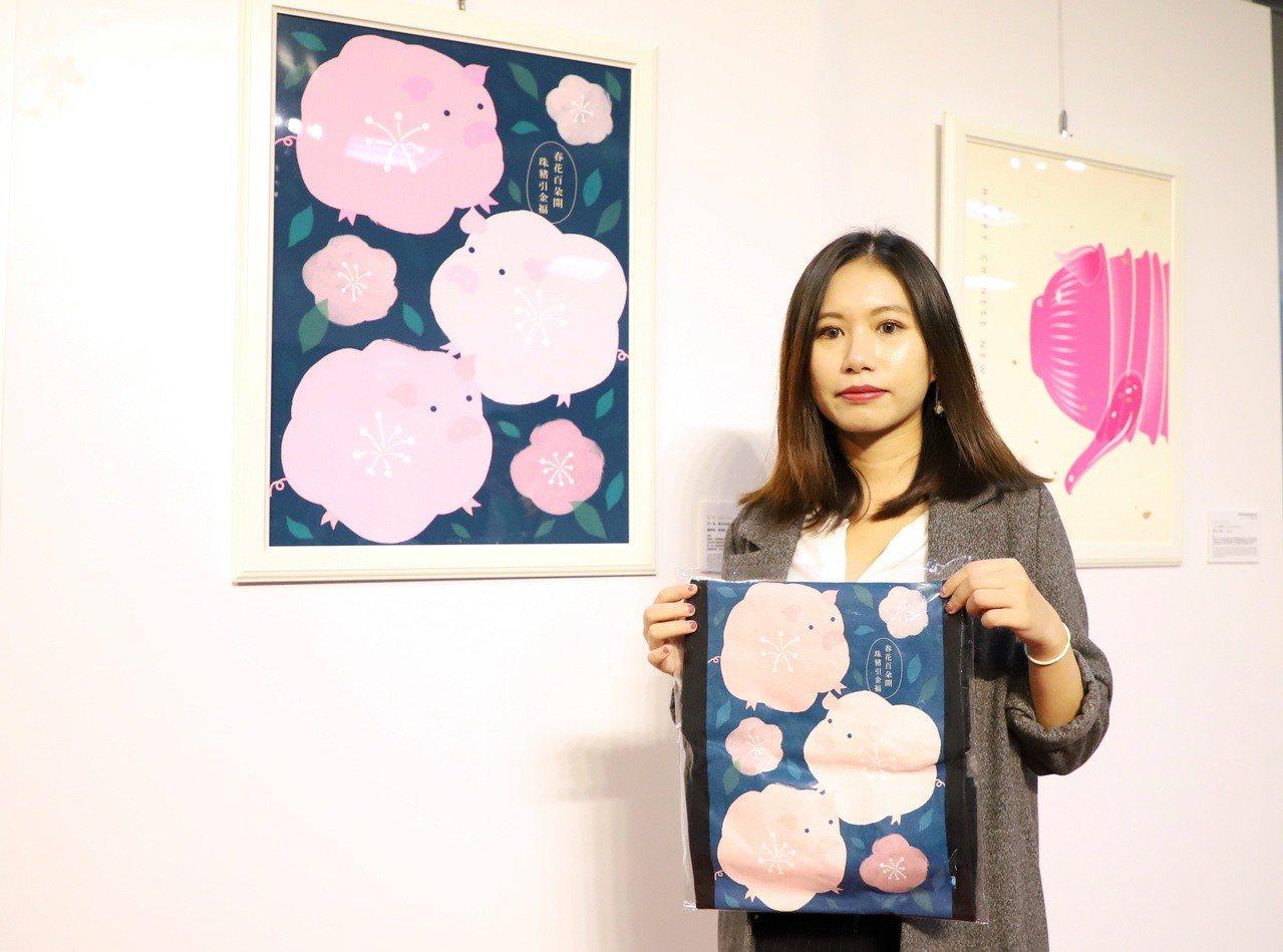 平面設計師張淳雅創作的「春花百朵開・珠豬引金福」奪下金獎。圖/台科大提供