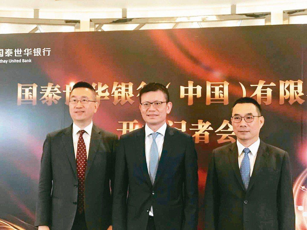 國泰世華銀行總經理李偉正(中)。 本報系資料庫