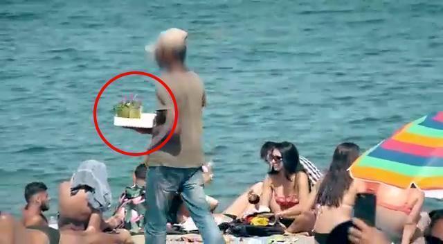 不肖攤商在巴塞隆納海灘上販售便宜的雞尾酒。圖/取自《太陽報》