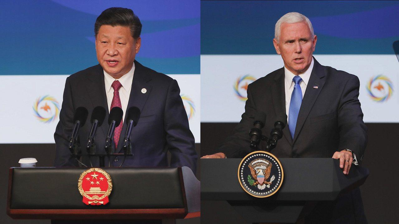 中國國家主席習近平(左)與美國副總統潘斯(右)。法新社