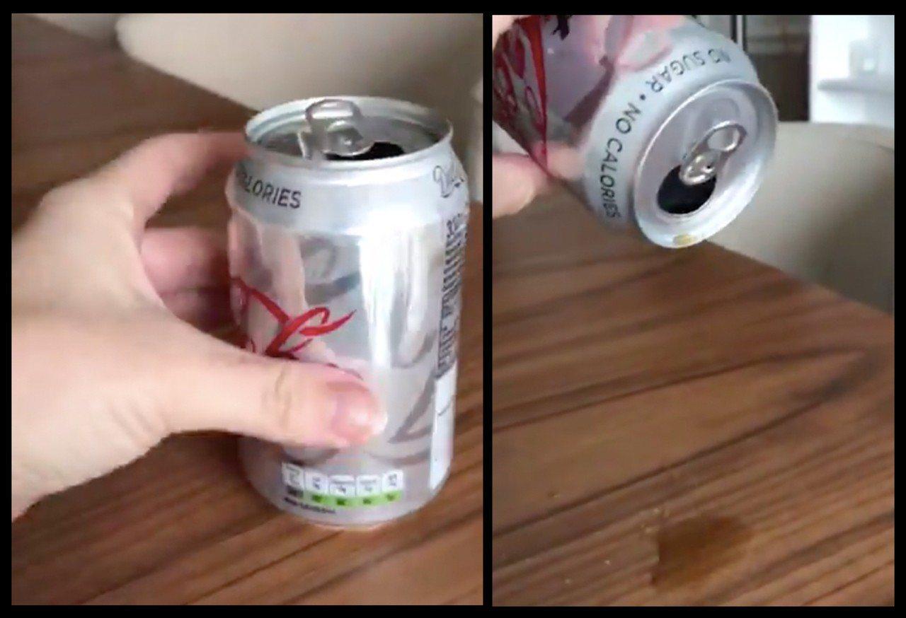 英婦人打開可樂罐,卻僅倒出少量可樂,可樂罐幾乎是空的。圖片來源/Twitter