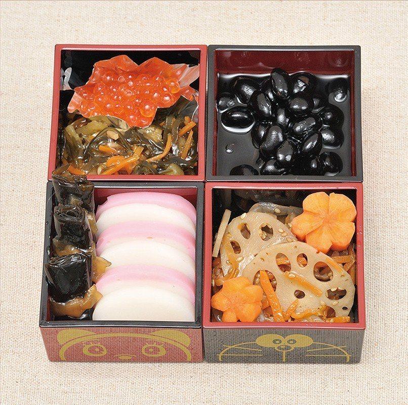 可承裝年菜的器皿,上頭有哆啦a夢與哆啦美的圖像。圖/擷取自日本郵便のネットショッ...