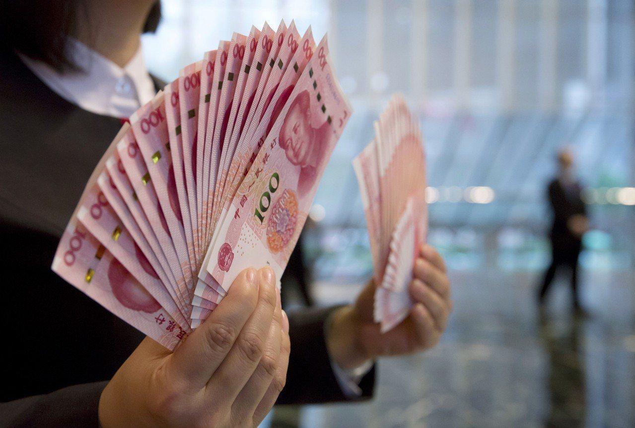 人民幣兌美元11月全月收升0.43%,是八個月來首現升勢。美聯社