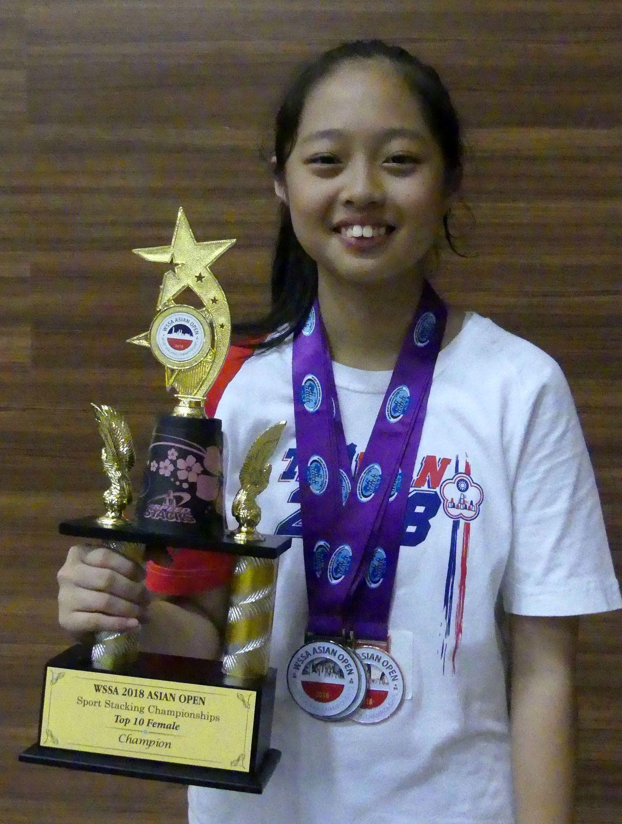 年僅12歲的梁晴,是2018亞錦賽全場疊杯速度最快的女生。圖/中華競技疊杯推廣協...