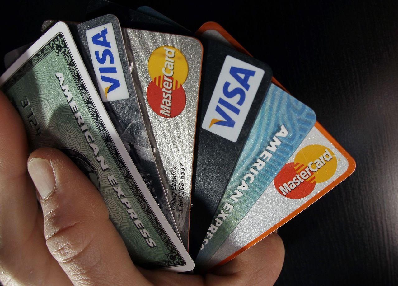 研究顯示,行動支付可能比刷卡付帳多花錢。美聯社