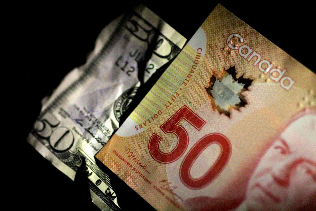 加幣兌美元貶至今年最低。路透