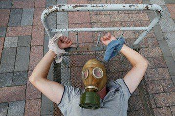 烏克蘭民眾於今年6月的國際聲援酷刑受害者日,抗議聲援酷刑受害者。 圖/路透社
