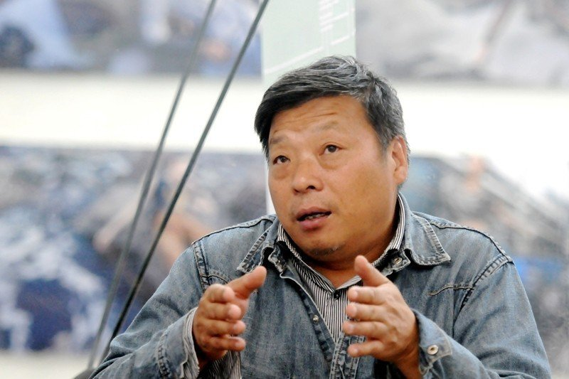今年11月,中國知名攝影師盧廣在新疆「被失蹤」。 圖/路透社