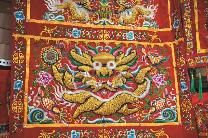 An embroidery for worship employs vivid ...