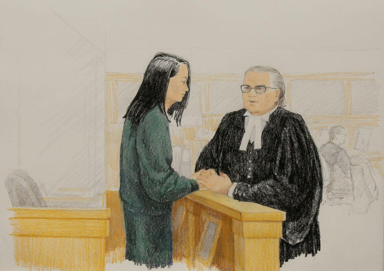 孟晚舟和律師在保釋聽證會。路透
