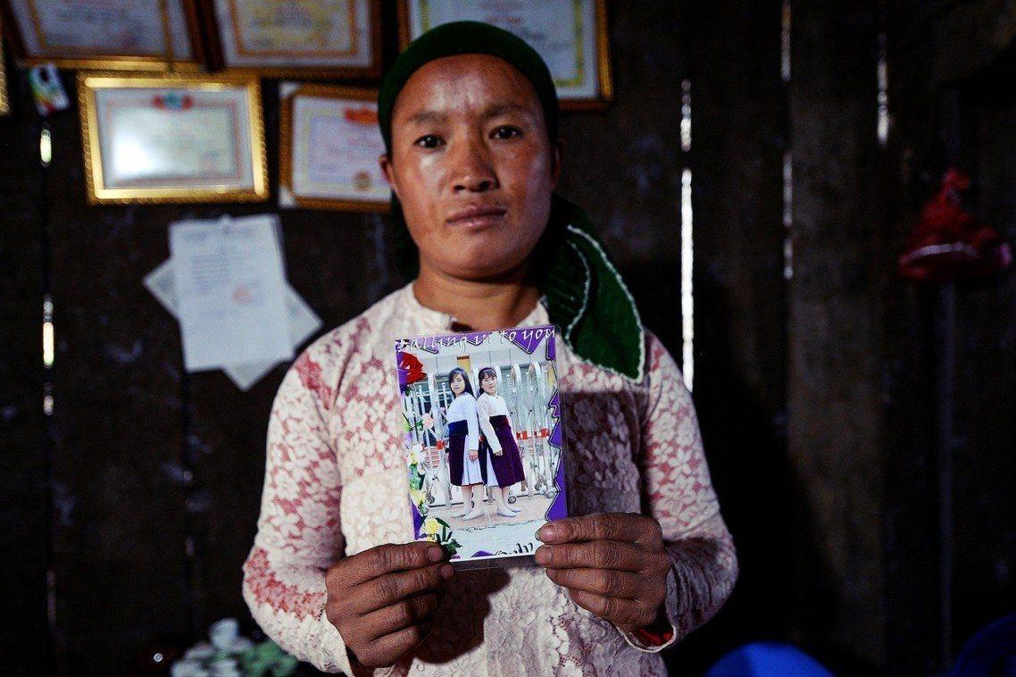「我只想著讓她們平安回家。」女兒被拐走的越南媽媽武氏丁。 圖/法新社