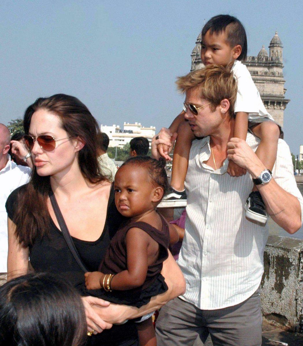 布裘曾經走到哪就把孩子帶到哪兒。圖/歐新社資料照片