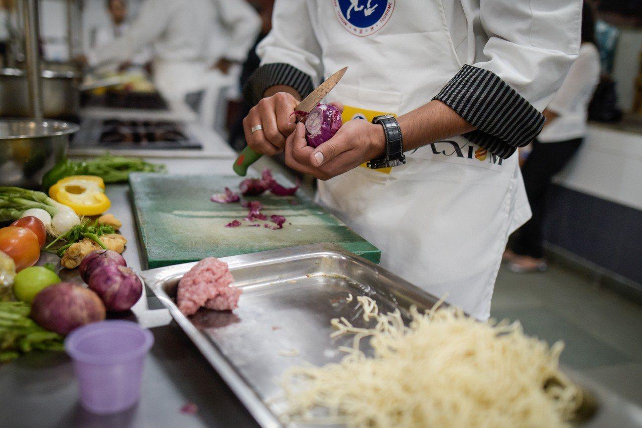 洋葱是印度料理的重要食材之一。(新華社)