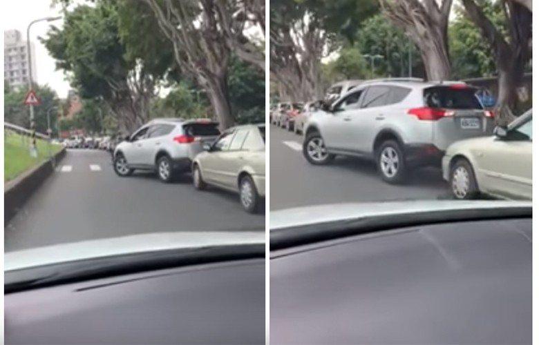 一網友po文表示日前目擊一輛休旅硬要塞入一個比車身還小的路邊停車空間,喬位置期間...