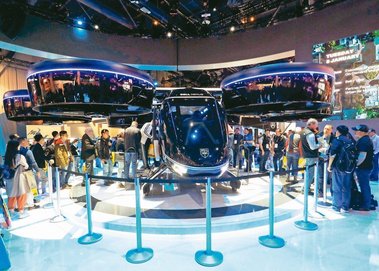 美國貝爾公司八日在拉斯維加斯消費電子展展出可垂直起降的Nexus空中計程車。 路...